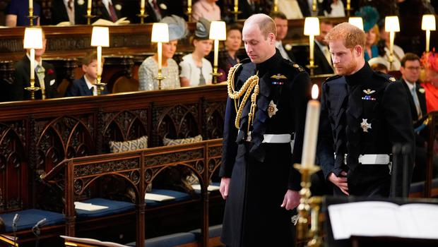 WINDSOR, UNITED KINGDOM - MAY 19: Prince Harry (right) and his best man, Prince William, Duke of Cambridge take their seats at St George's Chapel at Windsor Castle before the wedding of Prince Harry to Meghan Markle on May 19, 2018 in Windsor, England. (Photo by  Jonathan Brady - WPA Pool/Getty Images)