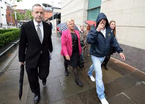 22.8.2013 PACEMAKER PRESS INTL. DUP councillor Ruth Patterson outside Belfast Laganside courts today as she was escorted by supporters who attempted to obstruct the media from filming using umbrellas etc. Patterson was in court facing charges relating to her Facebook comments regarding an imaginary attack on a republican parade in Castlederg. Picture Charles McQuillan/Pacemaker