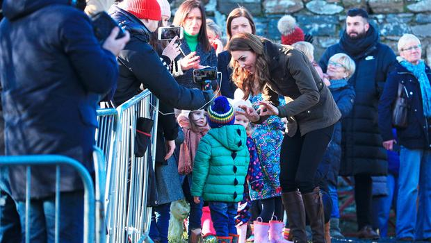 The Duchess of Cambridge speaks to members of the public as she arrives at The Ark Open Farm, at Newtownards, near Belfast, to meet with parents and grandparents to discuss their experiences of raising young children for her Early Childhood survey. PA Photo. Picture date: Wednesday February 12, 2020. See PA story ROYAL Kate. Photo credit should read: Peter Byrne/PA Wire