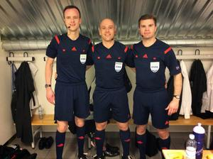 Gareth Eakin (right) on duty with referee Arnold Hunter (centre) and assistant referee Richard Storey