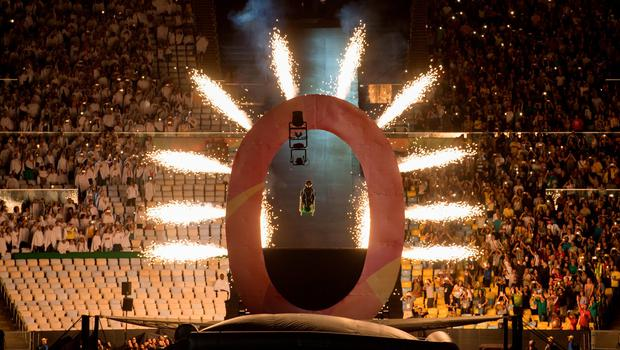Aaron Wheelz, an extreme wheelchair athlete, goes down a MegaRamp and tears through the panel with the number zero, marking the start of the Opening Ceremony of the Rio 2016 Paralympic Games at the Maracana Stadium. PRESS ASSOCIATION Photo. Picture date: Wednesday September 7, 2016. Photo credit should read: (Photo by Bob Martin for OIS via Press Association) Editorial Use Only.