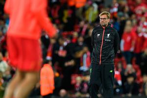 Liverpool's German manager Jurgen Klopp watches his players warm up ahead of the English Premier League football match between Liverpool and Manchester United at Anfield in Liverpool, north west England on October 17, 2016. AFP/Getty Images