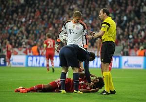 Manchester United's Wayne Rooney checks on the condition of Bayern Munich's Dante after they collided in the air during the Champions League, Quarter Final, Second Leg at the Allianz Arena, Munich, Germany.