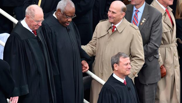 US Chief Justice John Roberts(BottomR), Justice Anthony Kennedy(L) and Justice Clarence Thomas(2nd-L) arrive on the platform of the US Capitol in Washington, DC, on January 20, 2017, before the swearing-in ceremony of US President-elect Donald Trump. / AFP PHOTO / Paul J. RichardsPAUL J. RICHARDS/AFP/Getty Images