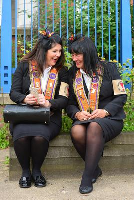 Thousands of Orange Order members are taking part in parades across Northern Ireland. The 12th of July parades mark the 326th anniversary of King William III's victory at the Battle of the Boyne in 1690. A total of 18 demonstrations are being held in towns and cities. Amanda Campbell and Joanne Liddle from Scotland pictured during the Belfast parade. Picture By: Arthur Allison /Pacemaker.
