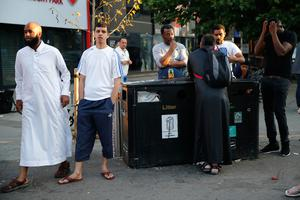 "Onlookers watch proceedings at the security cordon at the scene in Finsbury Park area of north London after a vehichle hit pedestrians, on June 19, 2017.  One man was killed and eight people hospitalised when a van ran into pedestrians near a mosque in north London in an incident that is being investigated by counter-terrorism officers, police said on Monday. The 48-year-old male driver of the van ""was found detained by members of the public at the scene and then arrested by police,"" a police statement said.  / AFP PHOTO / Tolga AKMENTOLGA AKMEN/AFP/Getty Images"