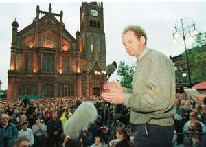 File photo dated 09/08/96 of Sinn Fein's Martin McGuinness addressing Nationalists outside the Guildhall in Serry after a march. PA