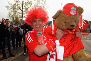 NORWICH, ENGLAND - APRIL 20: A Liverpool fan holds up a teddy bear ahead of the Barclays Premier League match between Norwich City and Liverpool at Carrow Road on April 20, 2014 in Norwich, England.  (Photo by Michael Regan/Getty Images)