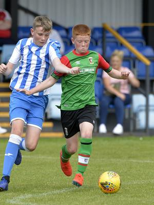 1st August 2019  Statsports Supercup NI 2019  Minor section semi final  match between Glentoran and Finn Harps at Seahaven in Portstewart. Glentorans Colby Smith in action with Finn Harps Tiernan McGinty Mandatory Credit : Stephen  Hamilton/Presseye