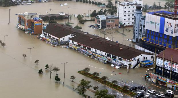 Buildings are submerged in floodwater after heavy rain in Gangneung South Korea, Thursday, Oct. 3, 2019