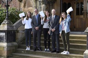 Education Minister, Peter Weir, pictured at a visit to Methodist College, Belfast with pupils (left-right) Caitriona Marsh, Lauren Bell and Zoe Hagan. Picture: Michael Cooper