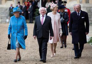 Queen Elizabeth II (left) walks with the President of Ireland Michael D. Higgins (2nd left), his wife Sabina (2nd right) and Prince Phillip (right) at Windsor Castle in Berkshire during the president's state visit