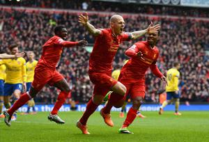 LIVERPOOL, ENGLAND - FEBRUARY 08:  Martin Skrtel of Liverpool celebrates scoring the opening goal during the Barclays Premier League match between Liverpool and Arsenal at Anfield on February 8, 2014 in Liverpool, England.  (Photo by Michael Regan/Getty Images)