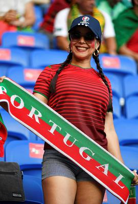 A Portugal fan waits for the start of the Euro 2016 semi-final football match between Portugal and Wales at the Parc Olympique Lyonnais stadium in Décines-Charpieu, near Lyon, on July 6, 2016.  / AFP PHOTO / PHILIPPE DESMAZESPHILIPPE DESMAZES/AFP/Getty Images