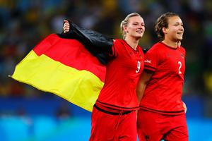 RIO DE JANEIRO, BRAZIL - AUGUST 19:  (L-R) Alexandra Popp of Germany and Josephine Henning of Germany celebrate victory at the end of the Women's Olympic Gold Medal match between Sweden and Germany at Maracana Stadium on August 19, 2016 in Rio de Janeiro, Brazil.  (Photo by Clive Brunskill/Getty Images)