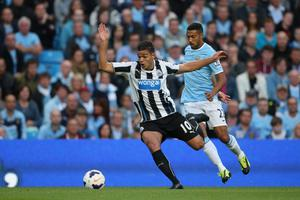 MANCHESTER, ENGLAND - AUGUST 19:  Hatem Ben Arfa of Newcastle United moves away from Gael Clichy of Manchester City during the Barclays Premier League match between Manchester City and Newcastle United at the Etihad Stadium on August 19, 2013 in Manchester, England.  (Photo by Clive Brunskill/Getty Images)