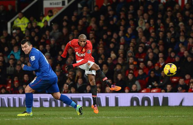 MANCHESTER, ENGLAND - JANUARY 28:   Ashley Young of Manchester United scores his team's second goal during the Barclays Premier League match between Manchester United and Cardiff City at Old Trafford on January 28, 2014 in Manchester, England.  (Photo by Michael Regan/Getty Images)