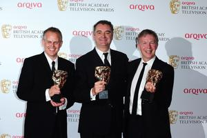 Left to right. Steve Smith, Jon Magnusson and Graham Stuart with the Best Entertainment Programme Award for The Graham Norton Show, at the 2013 Arqiva British Academy Television Awards at the Royal Festival Hall, London. PRESS ASSOCIATION Photo. Picture date: Sunday May 12, 2013. See PA story SHOWBIZ Bafta. Photo credit should read: Ian West/PA Wire