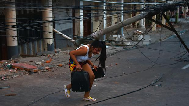 Picture taken in Manta, Ecuador, on April 17, 2016 a day after a powerful 7.8-magnitude quake hit the country. The toll from the big earthquake in Ecuador rose on Sunday to 246 dead and 2,527 people injured, the country's vice president said. / AFP PHOTO / LUIS ACOSTALUIS ACOSTA/AFP/Getty Images
