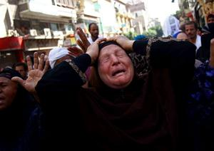 An Egyptian woman mourns after a judge in Egypt sentenced to death 683 people in the latest mass trial in the southern city of Minya, Egypt, Monday, April 28, 2014. (AP Photo/Ahmed Gomaa)