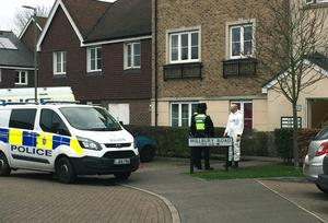 Police outside the address in Farnham (Lizzie Roberts/PA)