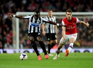 LONDON, ENGLAND - APRIL 28:  Cheik Ismael Tiote of Newcastle United holds off Aaron Ramsey of Arsenal during the Barclays Premier League match between Arsenal and Newcastle United at Emirates Stadium on April 28, 2014 in London, England.  (Photo by Jamie McDonald/Getty Images)