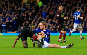 "Manchester City's Raheem Sterling (left) tangles with Everton's Tom Davies during the Premier League match at Goodison Park, Liverpool. PRESS ASSOCIATION Photo. Picture date: Sunday January 15, 2017. See PA story SOCCER Everton. Photo credit should read: Peter Byrne/PA Wire. RESTRICTIONS: EDITORIAL USE ONLY No use with unauthorised audio, video, data, fixture lists, club/league logos or ""live"" services. Online in-match use limited to 75 images, no video emulation. No use in betting, games or single club/league/player publications."