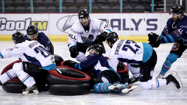 Belfast Giants players past and present compete in a game of musical chairs at Mark Garside's Testimonial at the SSE Arena (William Cherry/PressEye)