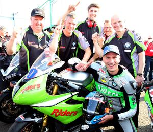 PACEMAKER BELFAST  11/05/2017 Martin Jessopp celebrates victory with his team mates during the Supersport race at the Vauxhall International North West 200 on Thursday evening. Photo Stephen Davison/Pacemaker Press