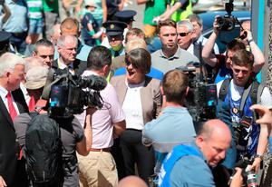 DUP Leader Arlene Foster (centre) at the Ulster final between Fermanagh and Donegal in Clones, Co Monaghan, Ireland. PRESS ASSOCIATION Photo. Picture date: Sunday June 24, 2018. Mrs Foster's attendance at a game synonymous with the nationalist tradition marks another symbolic milestone in cross-community engagement in the region. See PA story ULSTER Final. Photo credit should read: Niall Carson/PA Wire