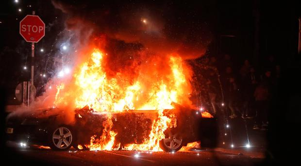 A burning car in Creggan, Londonderry after petrol bombs were thrown at police. PRESS ASSOCIATION Photo. Picture date: Thursday April 18, 2019. Photo credit should read: Niall Carson/PA Wire