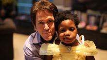 Tragic tale: Mitch Albom with Chika, the subject of his new book