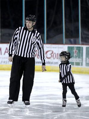 Elite League referee Andy Dalton with his son Eli at Belfast Giants' Mark Garside's Testimonial at the SSE Arena (William Cherry/PressEye)