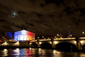 A photo taken on November 17, 2015 in Paris shows the moon shining over the building of the French National Assembly (L) illuminated with the French national colors in tribute to the victims of the November 13 Paris terror attacks. AFP PHOTO / JOEL SAGETJOEL SAGET/AFP/Getty Images