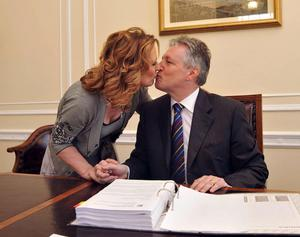 File photo dated 01/10/08 Northern Ireland's new First Minister Peter Robinson and his wife Iris kiss behind his desk after he was nominated as First Minister in the Parliament Buildings, Stormont, Belfast. Robinson and his wife Iris munched their way through 30,000 of food claimed for in their MPs' expenses over a four year period, according to the Daily Telegraph. PRESS ASSOCIATION Photo. Issue date: Friday May 15, 2009. MPs are allowed to claim up to 400 a month for food. See PA story POLITICS Expenses Ulster. Photo credit should read: PA/PA Wire