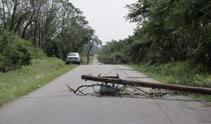 SHAWNEE, OK - MAY 20:  An electrical pole lies on a Pottawatomie County road after a tornado May 20, 2013 near Shawnee, Oklahoma. A series of tornados moved across central Oklahoma May 19, killing two people and injuring at least 21. (Photo by Brett Deering/Getty Images)