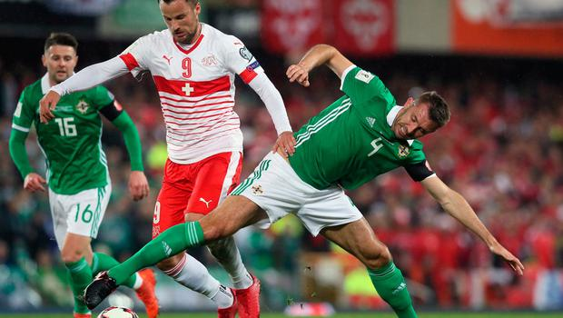 Switzerland's Haris Seferovic and Northern Ireland's Gareth McAuley (right) battle for the ball during the 2018 World Cup Qualifying Play-Off, First Leg match at Windsor Park, Belfast. PRESS ASSOCIATION Photo. Picture date: Thursday November 9, 2017.Brian Lawless/PA Wire.