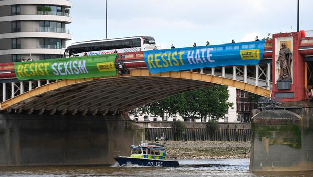 Activist from Amnesty International unfurl anti-Trump banners from Vauxhall Bridge in sight of the US Embassy in central London, on day one of US President Donald Trump's state visit to the UK. PRESS ASSOCIATION Photo. Picture date: Monday June 3, 2019. See PA story ROYAL Trump. Photo credit should read: Stefan Rousseau/PA Wire