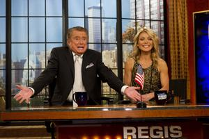 "Philbin and Kelly Ripa appear on Regis' farewell episode of ""Live! with Regis and Kelly"", in New York in 2011 (AP)"