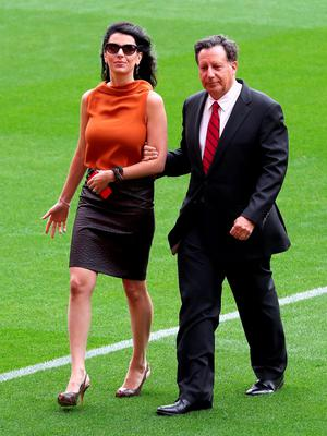 "Linda Pizzuti wife of Liverpool owner John W Henry (left) with Tom Werner ahead of the opening of the Anfield Main Stand, Liverpool. PRESS ASSOCIATION Photo. Picture date: Friday September 9, 2016. Photo credit should read: Peter Byrne/PA Wire. RESTRICTIONS: EDITORIAL USE ONLY No use with unauthorised audio, video, data, fixture lists, club/league logos or ""live"" services. Online in-match use limited to 75 images, no video emulation. No use in betting, games or single club/league/player publications."