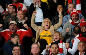 Arsenal supporters react after the team scored their second goal during their Champions League round of 16 second leg soccer match between Monaco and Arsenal at Louis II stadium in Monaco, Tuesday, March 17, 2015. (AP Photo/Christophe Ena)