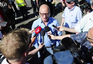 Pacemaker press 20/7/13 Billy Hutchinson speaks to the media during a protest that had been held after a contentious Orange Order parade was stopped by police in north Belfast. Three Orange order lodges had applied to march past the Ardoyne shops on the Crumlin Road but the Parades' Commission ruled against the move. Today's parade stopped on the Woodvale Road, at Woodvale Parade. The lodges were accompanied by a large crowd of supporters. picture Mark marlow/pacemaker press