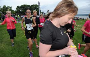 Belfast Telegraph Runher - Seapark to Crawfordsburn - 23rd May 2014 Presseye / Declan Roughan  The ladies set their watches at the start of the runner