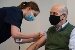 Broadcaster and author Loyd Grossman, 70, receives an injection of the Oxford AstraZeneca Covid-19 vaccine (Jacob King/PA)