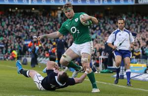 DUBLIN, IRELAND - FEBRUARY 02:  Stuart Hogg of scotland tries to tackle Jamie Heaslip of Ireland during RBS Six Nations match between Ireland and Scotland at the Aviva Stadium on February 2, 2014 in Dublin, Ireland.  (Photo by Ian Walton/Getty Images)