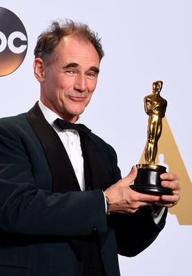 """Mark Rylance poses with his Oscar for Best Supporting Actor, """"Bridge of Spies,"""" in the press room during the 88th Oscars in Hollywood on February 28, 2016.    AFP PHOTO/FREDERIC J. BROWNFREDERIC J. BROWN/AFP/Getty Images"""