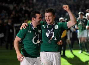 Ireland's Brian O'Driscoll and Dave Kearney (left) celebrate after the Six Nations match at the Stade de France, Paris, France