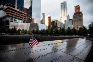 NEW YORK, NY - SEPTEMBER 11:  An American flag sits posted at the 9-11 Memorial site on September 11, 2015 in New York City. Today marks the 14th anniversary of the attacks where nearly 3,000 people were killed in New York, Washington D.C. and Pennsylvania.  (Photo by Andrew Burton/Getty Images)