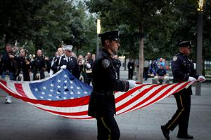 Members of the New York Police department attend a rehearsal at the 9/11 memorial before the ceremony to commemorate the 14th Anniversary of the terrorist attacks, on September 11, 2015 in New York.    AFP PHOTO/KENA BETANCURKENA BETANCUR/AFP/Getty Images