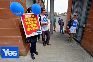 GLASGOW, SCOTLAND - SEPTEMBER 18:  Members of the public walk out of a polling station at Notre Dame primary school following casting their vote in the Scottish independence referendum on September 18, 2014 in Glasgow, Scotland. After many months of campaigning the people of Scotland today head to the polls to decide the fate of their country.  The referendum is too close to call but a Yes vote would see the break-up of the United Kingdom and Scotland would stand as an independent country for the first time since the formation of the Union.  (Photo by Jeff J Mitchell/Getty Images)